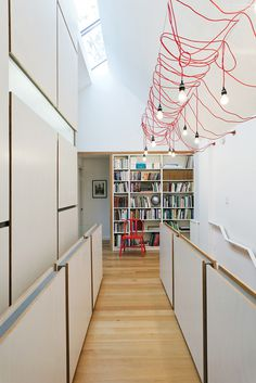 lighting up toronto tudor second story hallway open office library hanging fixtures made from ikea extension cords #interior design #archite