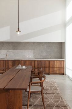 #Quartzite #kitchen and #diningarea with #highceiling. #PenthouseSWestkaaiAntwerp by #HansVerstuyftArchitecten. #diningroom