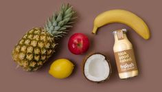 Various fruits representing the ingredients of Pineapple, Banana and Coconut Froosh