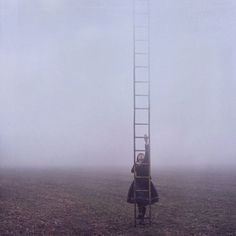 Lissy Elle | Colossal #clouds #fog #photography #ladder #climbing