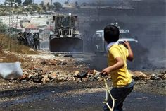 Palestinian boy throws stones at Israeli troops » Creative Photography Blog #photography