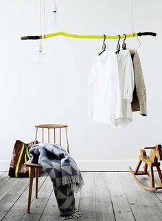 Neon Painted Driftwood Stick Window Display Idea? #wood #stick #yellow #hanger
