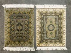 Two fine Koran-rugs made of silk. 20. Century, each approx. 62x47 cm