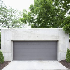 Concrete garage. B + W House by Snow Kreilich Architects. © Dean Kaufman. #garage