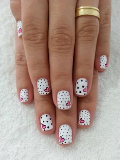 Polka dots and pink heart nail art