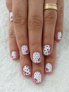 Polka dots and pink heart nail art