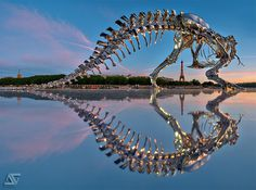 Giant Chrome T Rex Installed on the Seine River in Paris by Philippe Pasqua
