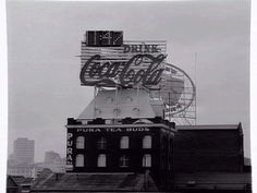 [Coca-cola sign and clock above Pura Tea Buds building, South Melbourne] [picture] , State Library of Victoria #coke #photography #coca #cola