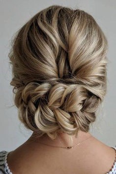 Updo hairstyles for brides look so pretty and graceful. They are definitely suitable for the great atmosphere of a wedding day.