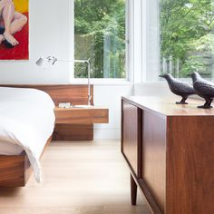 Custom platform bed by Christian Woo lies perfectly beneath the bedroom windows. Tagged: Bedroom, Bed, Table Lighting, Dresser, and Light Hardwood Floor. Photo 38 of 48 in Best Bedroom Bed Dresser Photos from Custom Millwork and Bright Interiors Star in an Elegant Vancouver Home