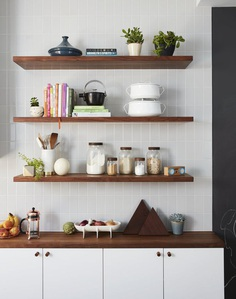 Kitchen, White Cabinet, Wood Counter, and Subway Tile Backsplashe A mix of IKEA and custom walnut shelving; gray subway tile from Nemo Tile; and accessories from Food 52. Photo 8 of 15 in Before & After: A Humdrum Home in Brooklyn Receives a Stylish Revamp