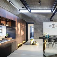 Raw Concrete and Black-Painted Metal Give Industrial Feeling to Jacobs-Yaniv House 6