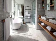 Luxury Penthouse Designed by Amos and Amos carrara marble tiles floor walls bathroom #bath #design #bathroom