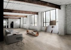 tumblr_lj1bwyfq2x1qc8toao1_500.jpg (500×359) #brick #couch #office #home #walls #light