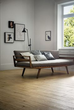Brilliant- design to keep the couch platform from warping. Upright framed box, with crossing flat ribs. #interior #floors #couch #wood #light