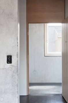 Wood and concrete. Rüthi by Schneider Türtscher Architekten. © Johanna Muther. #door #concrete #wood