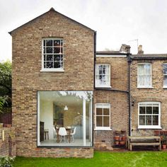 London house extension by Cousins and Cousins has a window wrapping its corner #window