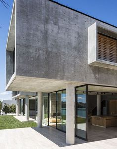 Massive Concrete Home on a Cliff Above Hobson Bay 1