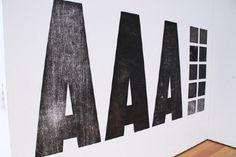 Triple A type on a wall #type