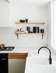 Kitchen with black and brass detail. Park View House by Arent&Pyke. Photo by Felix Forest. #kitchen #parkviewhouse #arentandpyke