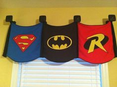 Superhero Banners As a toddler, you can start adding additional decorations to your little boy's room. How about getting the logos of his