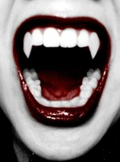 Nice fangs, nice lipstick. I am assuming the color was, erm, enhanced via photoshoppy magic, because I have NEVER found that color of lipsti #vampire