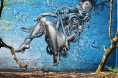 Woman with octopus in real graffiti street art