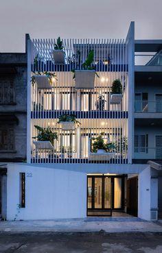 DANstudio Renovates House in Hanoi with Green Balconies Facade 14
