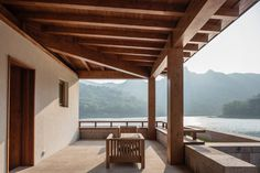 Veranda overlooking lake. Shidao Resort by Duoxiang Studio. #veranda #asian #beam