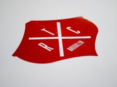 The Red Canoe : mCroxton Design #white #red #cross #seal #shield