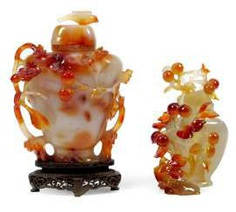 Two floral carved lid vases made of agate
