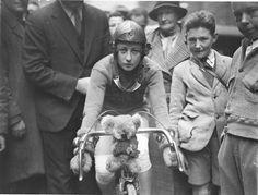 Close-up of Billie Samuel on the Malvern Star bike showing her koala bear mascot before leaving for Melbourne, 4 July 1934, by Sam Hood | Fl #white #koala #bicycle #of #samuel #july #black #4th #bike #and #billie
