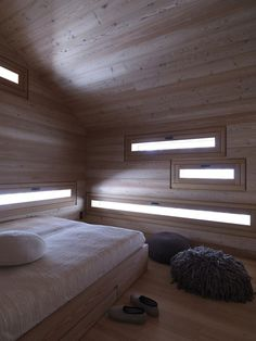 cozy-mountain-cabin-can-open-to-elements-6-bedroom.jpg #cabin #bedroom #light #windows