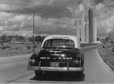 Early view of Satelin Torres and taxi. No traffic. #urbanism #barragan #concrete #architecture