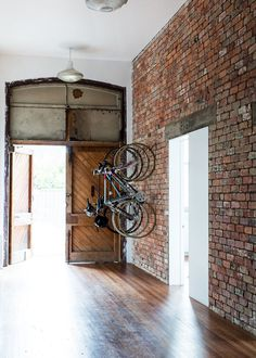 Inside home, there's a place for bikes #interior #bikes #brick #door #design #bicycles #wall #deco #decoration