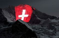 A Giant Light Installation Illuminates the North Face of the Jungfrau Mountain » Design You Trust – Design and Beyond! #swiss #installation #flag #switzerland #light