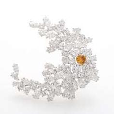 GÜBELIN fashionable brooch with numerous diamonds