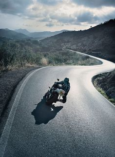 motorbike_rider_on_a_twisting_open_road #rider #motorbike #road
