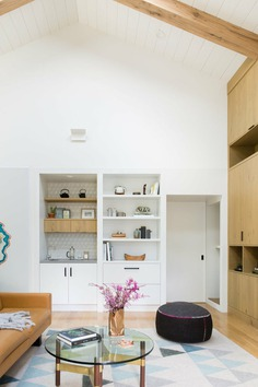 Designer Regan Baker crafts a fun and unconventional home for a creative couple and their cats