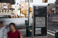 A new system of wayfinding signs helps pedestrians navigate New York City streets.