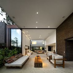Luxurious and Sophisticated Spirit of Brazilian Weekend Home barbecue space retreat terrace #design #living #home #architecture #outdoor #room