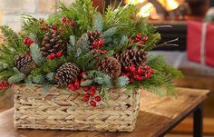 Fill a basket with greenery, pinecones, and dried berries for a centerpiece or decoration bursting with yuletide cheer. #christmas #diy #holiday