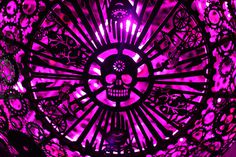 Recycled Bike Part Chandeliers Under a Texas Overpass #color #purple #chandelier #skull #light