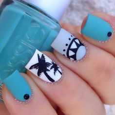 A cool and summer inspired blue nail art design. Light blue, white and gray blue polishes are used as background with black polish silhouett