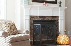 The Stratford Companies #design #living #home #marble #fireplace #room