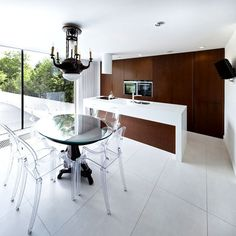 Perforated House Simple Cube with no Balconies kitchen black white dark wood #ideas #interior #kitchen #design