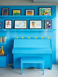 Blue room interior with child art decor