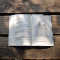 a transparent acrylic book paperweight to hold down the pages of a book from flipping as you enjoy tea while you read