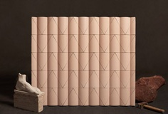 """The Reed tile can be arranged diagonally, unaligned, rotated, or quilted. In this example, a Single Reed tile wall follows the """"Perfect Reed"""" arrangement, with each fold located approximately 8 inches from the next. (Courtesy Madhava Kalmar/Kaza Concrete)"""
