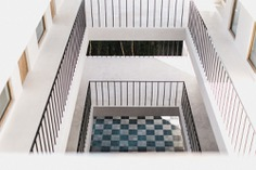 The view from the top floor to the checkerboard tiles on the ground floor.